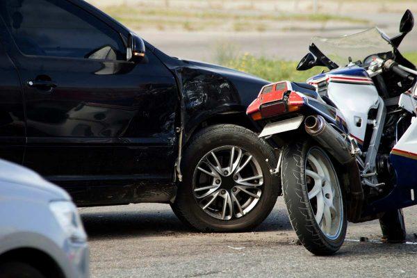 crash car and moto bike on road